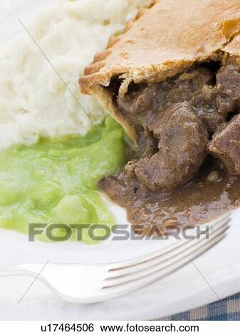Stock Images of Steak Pie and Mash with Mushy Peas ...