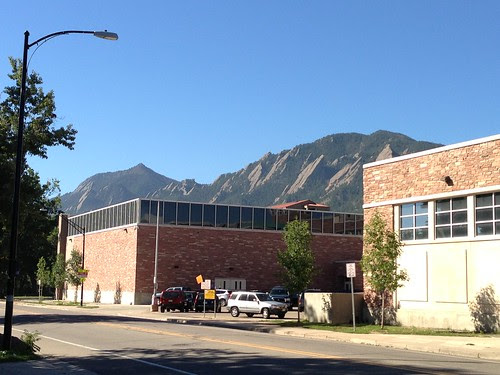 The Rockies looming behind a building, Boulder, Colorado