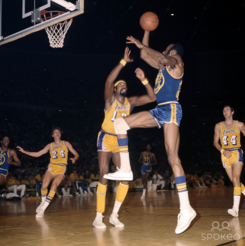 vintagesportspictures:<br /><br />Nate Thurmond shooting over Wilt Chamberlain (1970)<br />