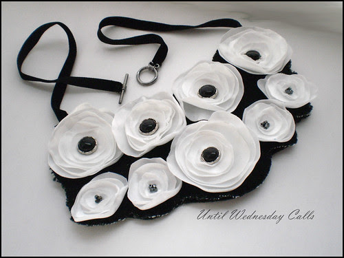 Singed flower bib necklace