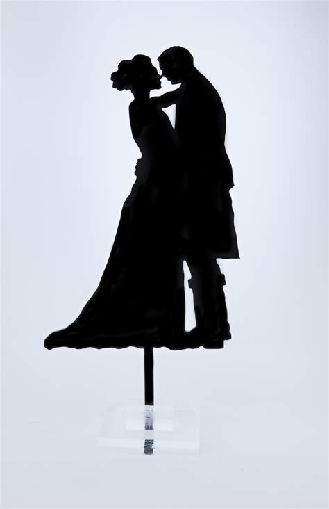 Silhouette Kissing Bride and Scottish Groom in Kilt