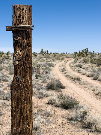 Old wooden signpost on a trail in the Mojave Desert