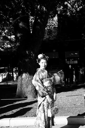 Girl in kimono under a tree