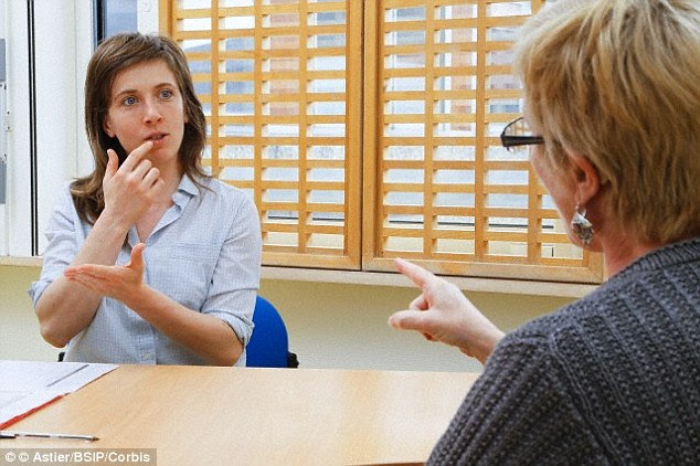 It IS hoped the new technology could help people with hearing and speech impairments communicate more easily. A stock image of a deaf woman using sign language is shown above