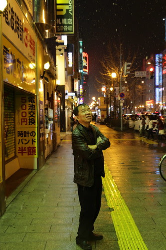 Dad watches the snow in Sapporo