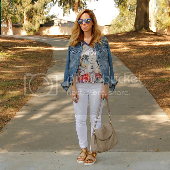 LA fashion blogger The Key To Chic wears an AG Jeans jacket, Peter Som for Kohl's postcard print sweatshirt, white Gap jeans, and Aldo Parramore sandals