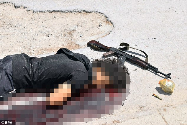 Gunman: Police said a bomb was found on Seifeddine Rezgui's body moments after he was killed, although this photo appears to show a bomb and a detonator next to him