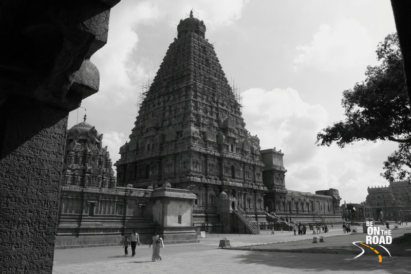 Old Tamil Script in the foreground and the great living chola temple in the background