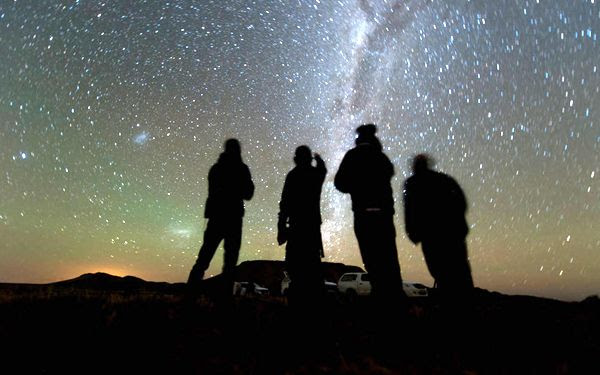Four members of the South African observation team for NASA's New Horizons mission scan the sky while waiting for the start of the 2014 MU69 occultation...on June 3, 2017.