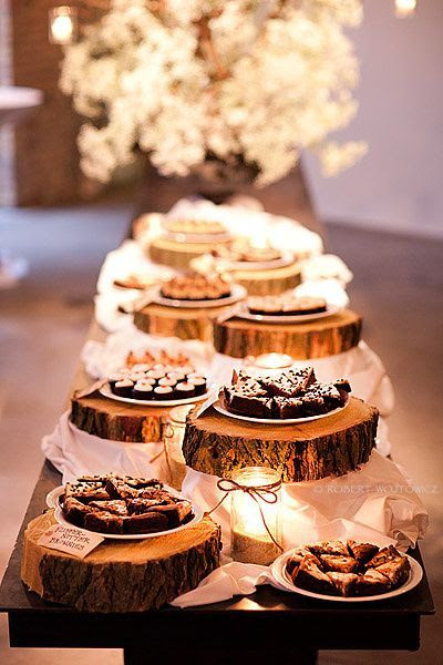 Great idea! Place the wedding reception food or desserts on cut out pieces of wood to add that rustic or country theme.