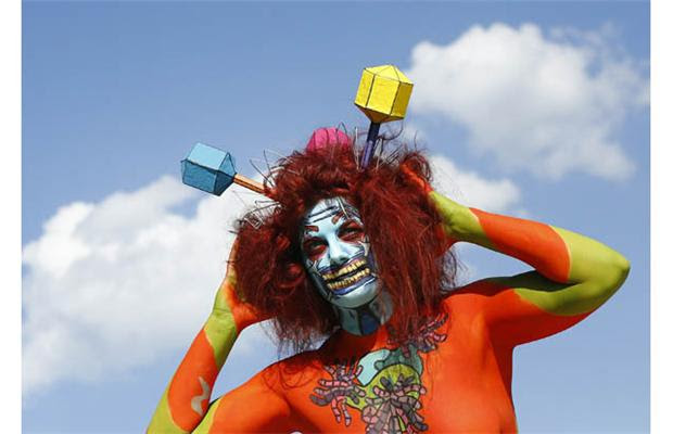 A participant poses with her body paintings during the 15th World Bodypainting Festival in Poertschach on July 7, 2012. Some 30,000 visitors are expected at the three-day event, with over 200 artists from 44 countries showing off their creations in the hope of taking home a prestigious World Award, the equivalent of a world championship title