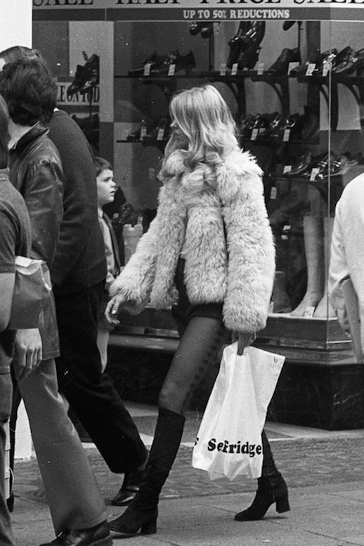 Le Fashion Blog 1970s 70s Street Style Vintage Photos Shag Shaggy Fur Coat Shorts Tights Suede Knee High Boots Tres Blase