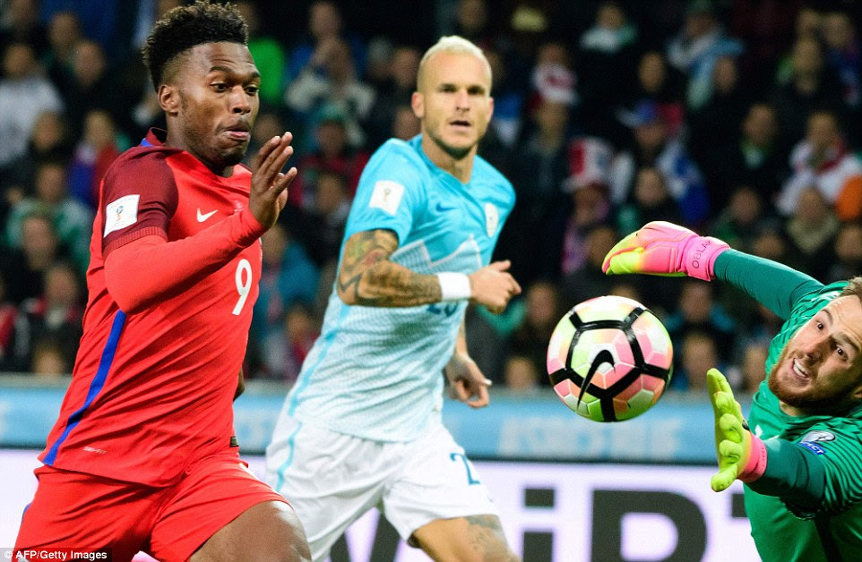 Oblak (right), who plays club football for Atletico Madrid, pushes the ball away from danger under pressure from Sturridge