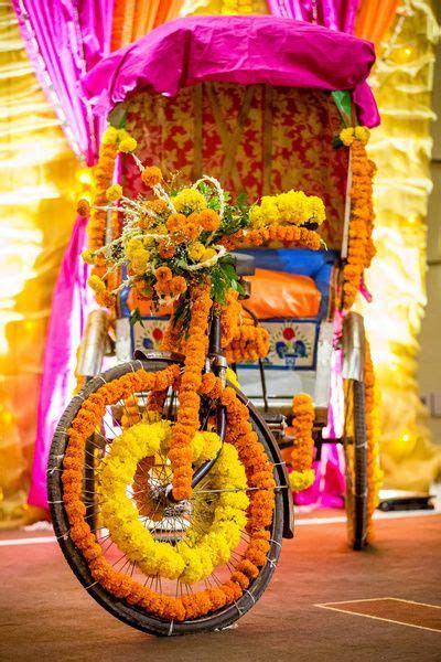 Decorated rickshaw with genda phool for mehendi   decor