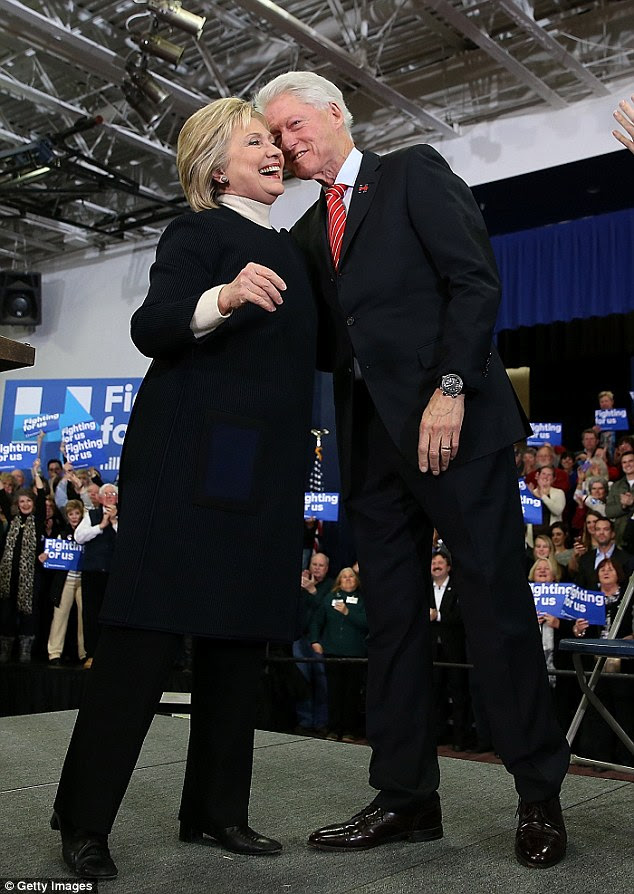 If Hillary Clinton (pictured on the campaign trail) is elected president, the Clintons would be protected from criminal investigations into the Clinton Foundation