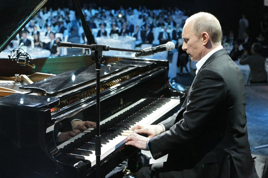 Vladimir Putin plays the piano at a charity concert in St. Petersburg, December 10, 2010.