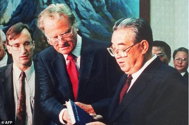 Billy Graham presented his book 'Peace with God' to North Korean President Kim Il Sung when they met in Pyongyang in 1992