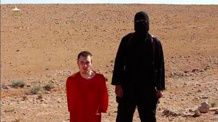 © Reuters. Estado Islámico decapita a un rehén británico en un nuevo video