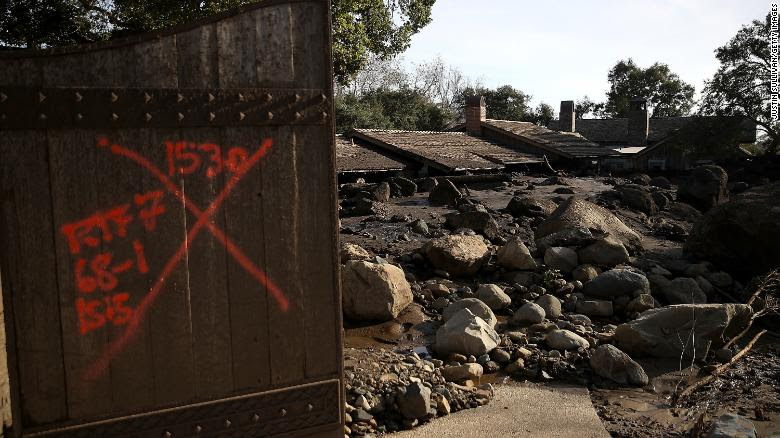 Debris from a mudslide covers a home in Montecito on Wednesday.