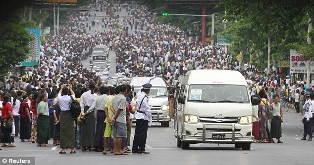 Quite the crowd: Throngs of supporters lined the street as the presidential motorcade drove through Yangon