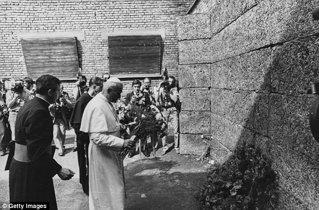 Pope John Paul II laying flowers as he visits Auschwitz-Birkenau, the former Nazi concentration camp in Poland on June 7, 1979