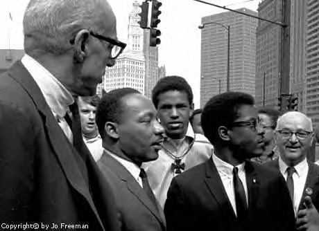Dr. Martin Luther King, Jr. with Dr. Benjamin Spock and Bernard Lee at Chicago's anti-war march in March of 1967. by Pan-African News Wire File Photos