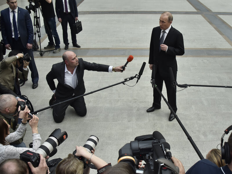Russian President Vladimir Putin speaks with members of the press after his annual call-in show in Moscow on April 14.