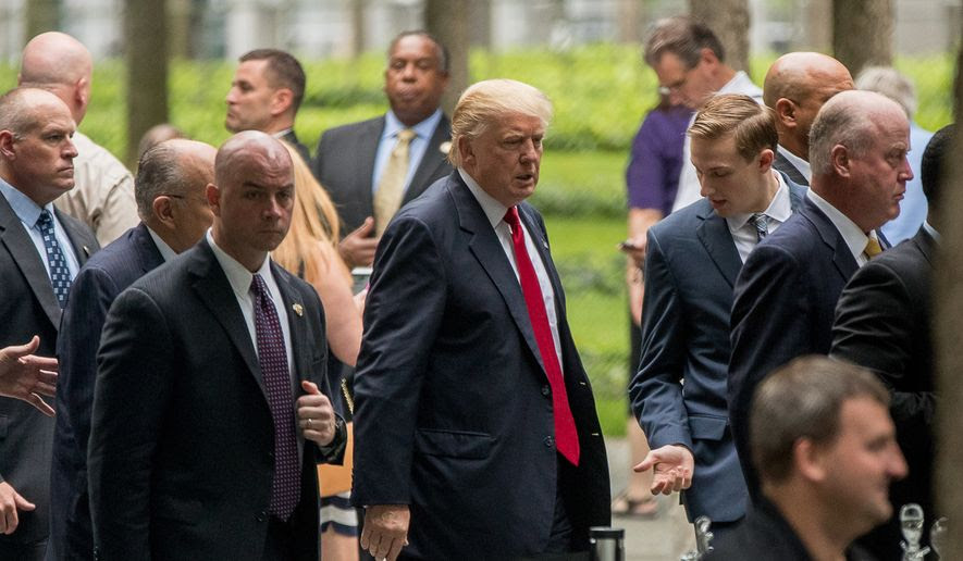 Republican presidential candidate Donald Trump, center, arrives to attend a ceremony at the National September 11 Memorial, in New York, Sunday, Sept. 11, 2016, on the 15th anniversary of the Sept. 11 attacks. (AP Photo/Andrew Harnik)