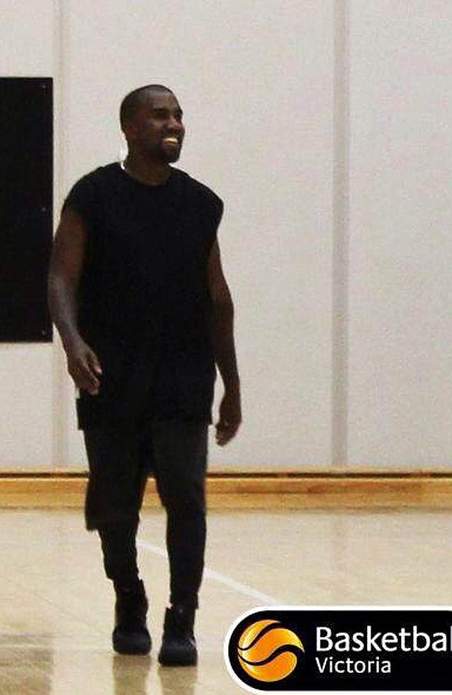 Kanye West playing basketball during his Melbourne visit.