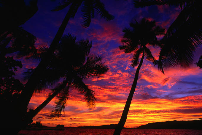 Wonderfully vibrant sunset over Marovo Lagoon in the Solomon Islands.