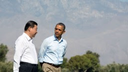 President Barack Obama walks with President Xi Jinping of the People's Republic of China on the grounds of the Annenberg Retreat at Sunnylands in Rancho Mirage, Calif., June 8, 2013.