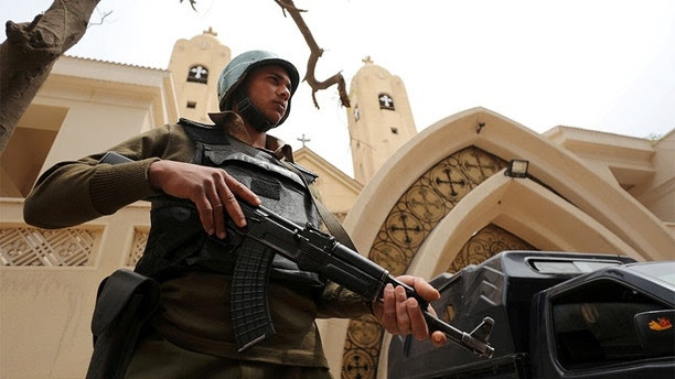 FILE PHOTO: An armed policeman secures the Coptic church that was bombed in Tanta, Egypt April 10, 2017. To match Special Report EGYPT-POLITICS/SINAI    REUTERS/Mohamed Abd El Ghany/File Photo - RC1694D3C800