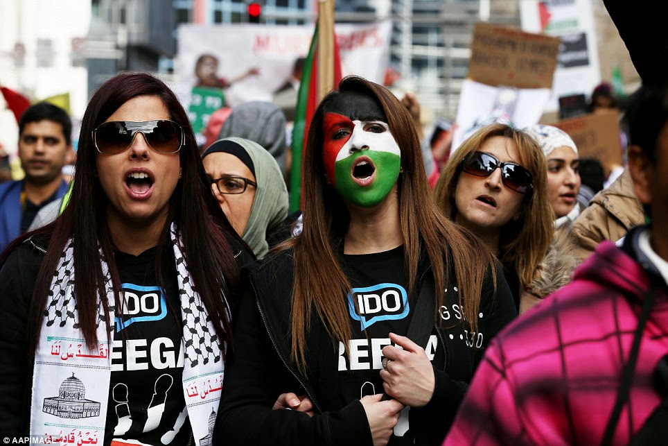 Pro-Palestinian protestors painted their faces and wore t-shirts that said 'free Gaza' as they gathered to march the streets of Sydney
