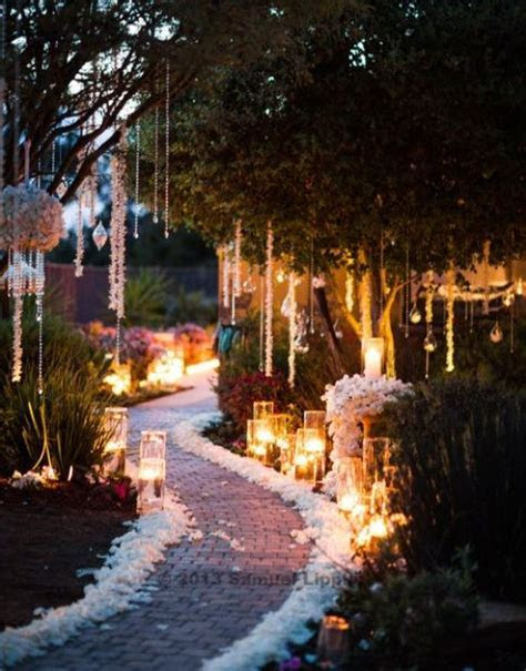 Candle lit garden wedding ceremony aisle   Midsummer night