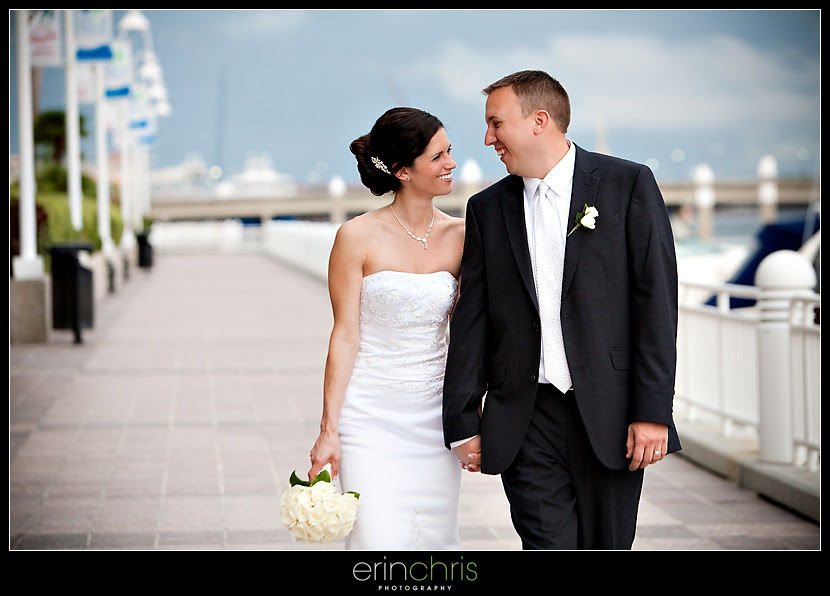 bride and groom walking along the tampa riverwalk