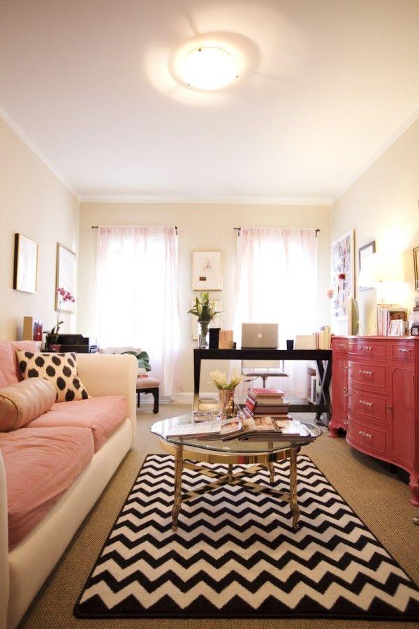 Pink buffet, black and white chevron rug. Beautiful feminine office.