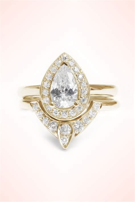 Third Eye Pear Diamond Engagement Ring with Matching Side
