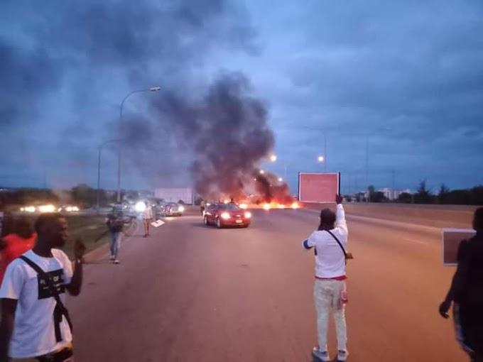 UPDATE: #BuhariMustGo Protesters Block Abuja Airport Road