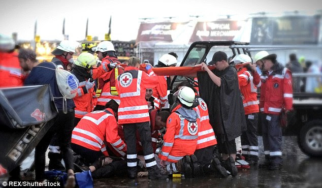 Emergency services attending to a man at Rock-am-Ring festival, It is believed the man was hit by lightning when a storm passed over the festival