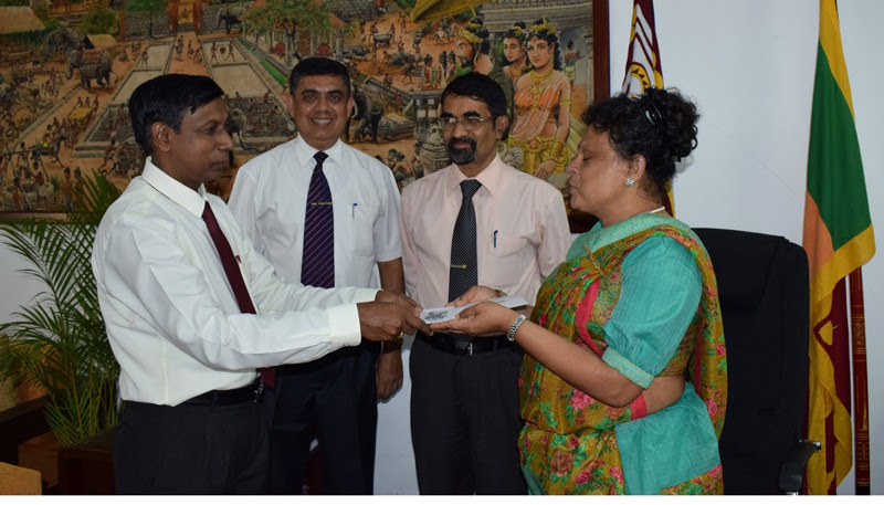 New Education Secretary R. M. P. S. Rathnayaka receiving his appointment letter from Governor Niluka Ekanayaka. Central Province Chief Secretary Sarath Premawansha and the Governor's Secretary Tissa Karunarathna are also in picture.
