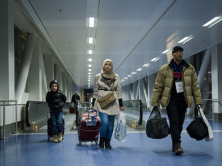 In a photograph from November, 2015, a Syrian family arrives in Detroit. Donald Trump's recent executive order has stymied refugees who have already completed most of the resettlement process.