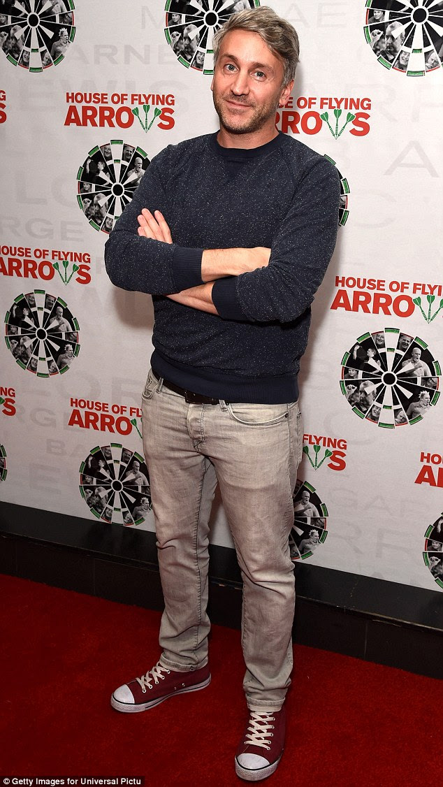 Strike a pose: Director Daniel Mendelle kept things casual in converse shoes, paired with a jumper and jeans