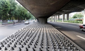 Concrete spikes under a road bridge in Guangzhou city, Guangdong, China.