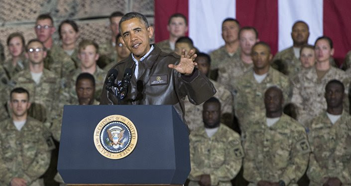 US President Barack Obama speaks during a surprise visit with US troops at Bagram Air Field, north of Kabul, in Afghanistan, May 25, 2014, prior to the Memorial Day holiday