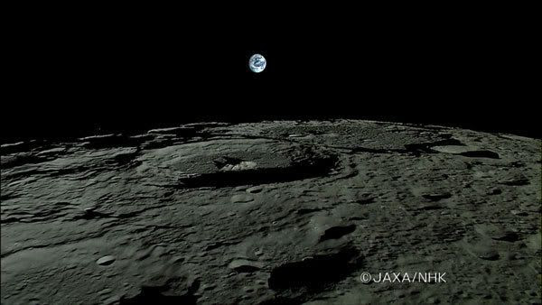 The Earth rises above the lunar horizon in this video screenshot from the Kaguya spacecraft.