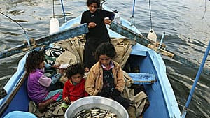 A girl rows her family's fishing boat on the Nile in April 2013. Most of Egypt's population is clustered around the river and its delta, and draw their livelihoods from it in one way or another.