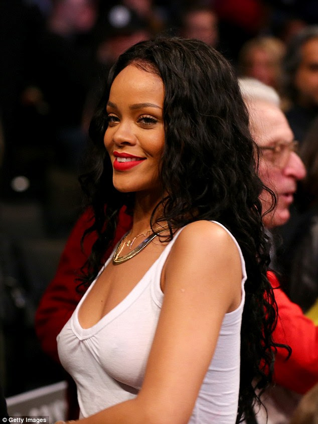 Courting attention: Rihanna garnered lots of attention as she went bra-less at the Barclays Center in the Brooklyn borough of New York City