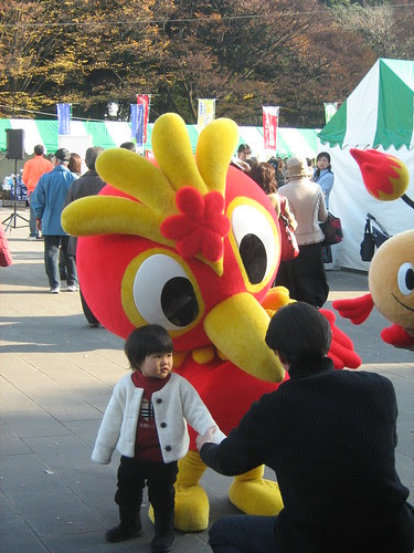 Little kid and mascot at Ueno Park