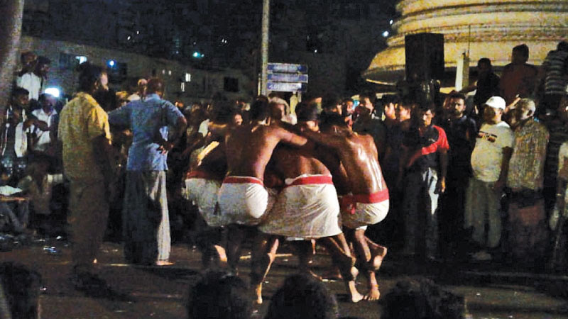 Angampora dancers keeping the crowd entertained.