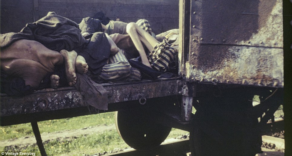 Merciless: The dead are loaded onto a train for disposal